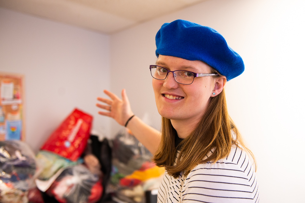 Penelope with a collection of clothes that will be featured at the next Affirm Project clothing swap.