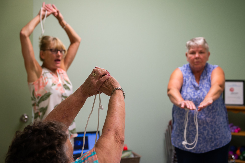Katherine and Mary leading an seniors' exercise class